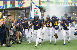 Nov 28, 2015; Morgantown, WV, USA; West Virginia Mountaineers running back Wendell Smallwood (4) leads the West Virginia Mountaineers out on the field prior to their game against the Iowa State Cyclones at Milan Puskar Stadium. Mandatory Credit: Ben Queen-USA TODAY Sports