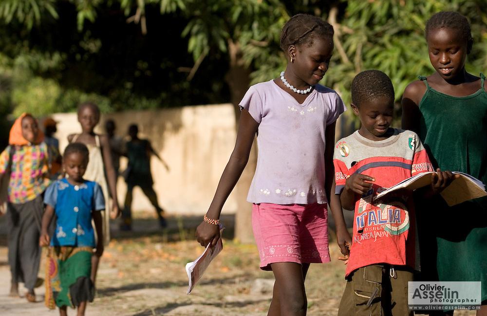 Children walk to school in the village of Bourofaye, Senegal, on Wednesday June 13, 2007.