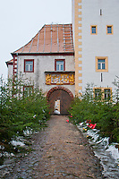 Close-up of the entrance, Chemnitz Castle, Germany.  Christmas line the path to the doors.