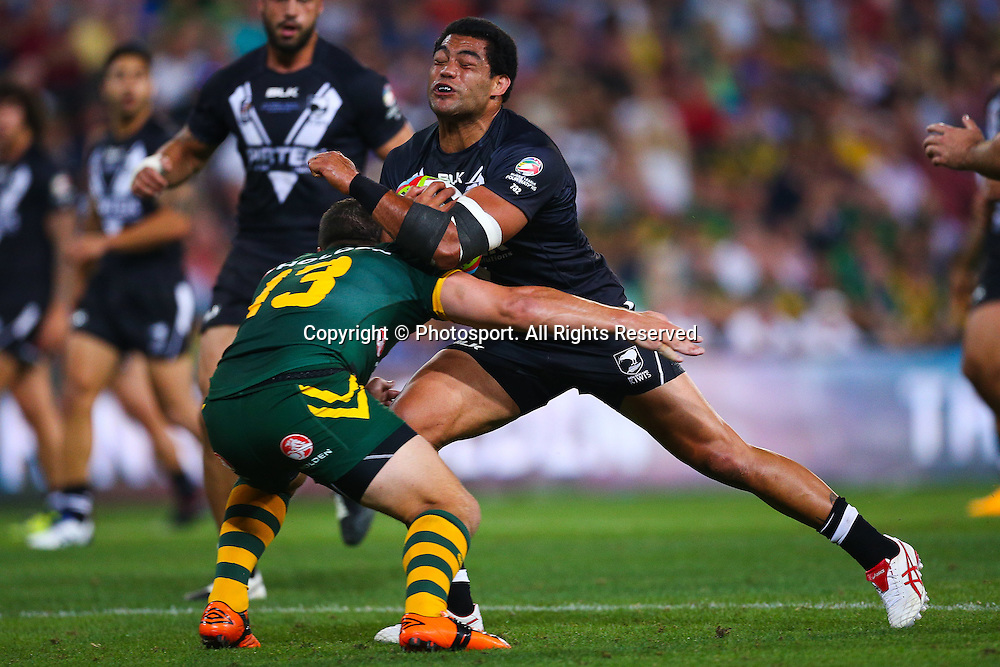 Adam Blair is tackled by Greg Bird during the Four Nations test match between Australia and New Zealand at Suncorp Stadium,  Brisbane Australia on October 25, 2014.