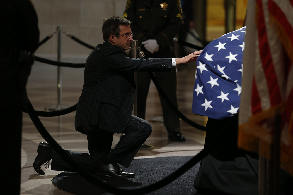 Michael Pappas pays his respect as San Francisco Mayor Ed Lee lies in state at City Hall on Friday, Dec. 15, 2017, in San Francisco, Calif. Lee died on Tuesday from a heart attack. He was 65 years old.