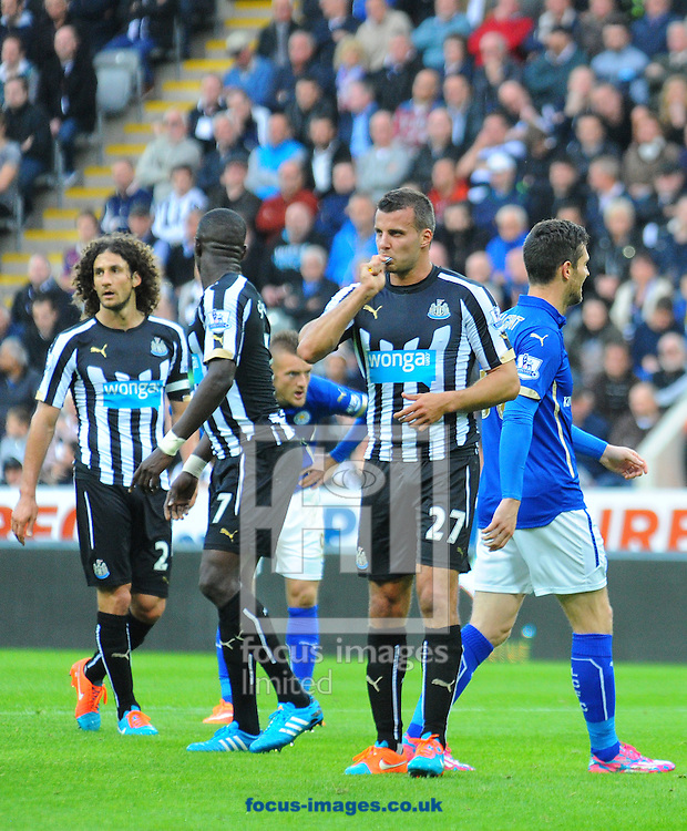 Steven Tayor of Newcastle United eats something during the Barclays Premier League match at St. James's Park, Newcastle<br /> Picture by Greg Kwasnik/Focus Images Ltd +44 7902 021456<br /> 18/10/2014
