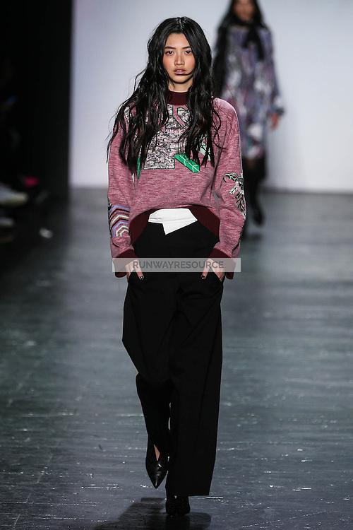 Wu-I Hua walks the runway wearing Vivienne Tam Fall 2016 during New York Fashion Week on February 15, 2016