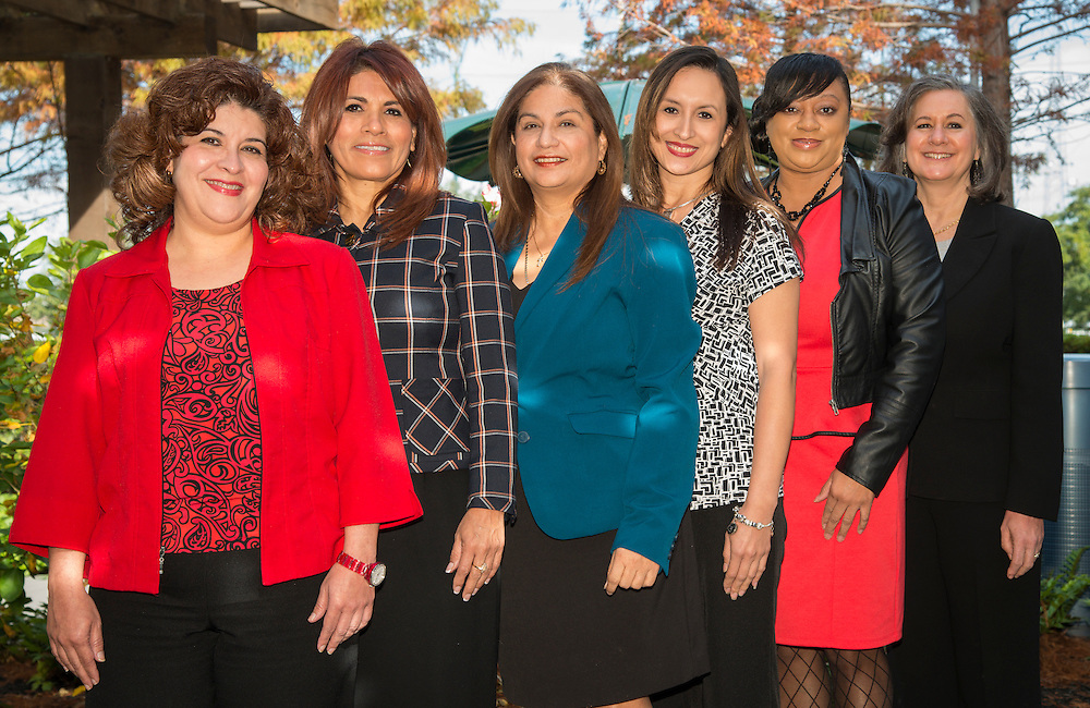 L-R: Houston ISD Parent & Community Relations team members Christina Oliveros, Marina Garcia, Alma Aguilar, Melissa Lopez, Ta Kisha Walker and Suzanne Mihaloglou pose for a photograph, December 12, 2013.