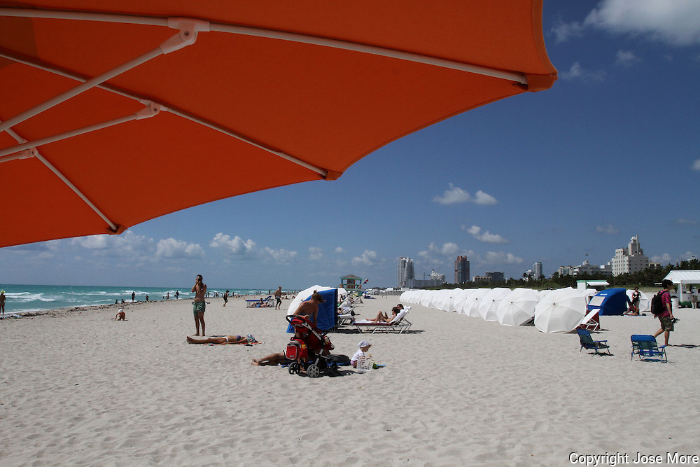 The eclectic South Beach neighborhood of Miami Beach glitters with nightlife &ndash; all day long along its Art Deco hotels. People watching is a great pastime in this trendy and quirky area which draws celebrities and beautiful people from all over the world. Enjoy the beach or the historic Art Deco architecture or the fine Oceanside dining. <br /> <br /> Photography by Jose More