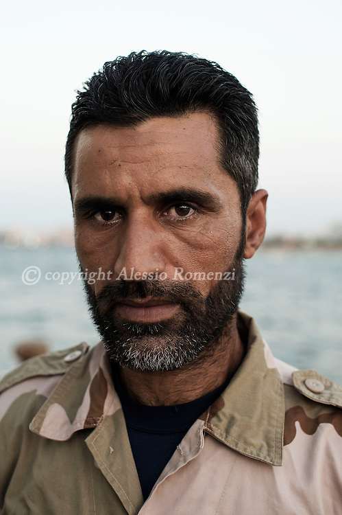Libia, Tripoli: Mohammed, a Coastal guard member poses for a portrait at the Tripoli port. Alessio Romenzi