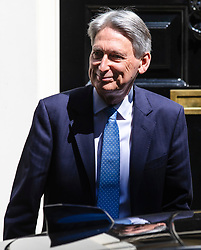 © Licensed to London News Pictures. 21/05/2019. London, UK. The Chancellor of The Exchequer Philip Hammond leaves 10 Downing Street after the Cabinet meeting. Prime Minister Theresa May is expected to make a statement to Paliament outlining changes to the Withdrawal Agreement Bill before it is brought back before Parliament. Photo credit: Rob Pinney/LNP