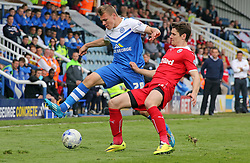 Peterborough United's Harry Anderson in action with Crawley's Josh Simpson - Photo mandatory by-line: Joe Dent/JMP - Mobile: 07966 386802 - 25/04/2015 - SPORT - Football - Peterborough - ABAX Stadium - Peterborough United v Crawley Town - Sky Bet League One