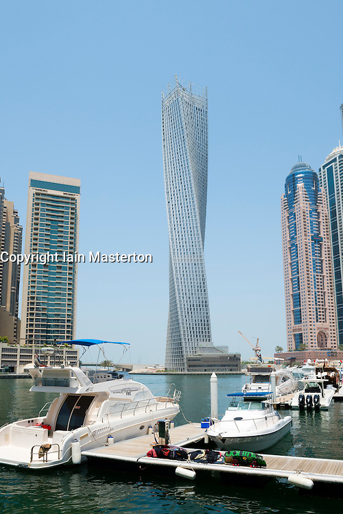 Modern high rise skyscrapers and Cayan Tower in Marina district of Dubai United Arab Emirates