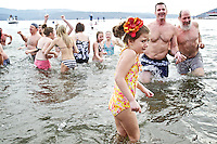 Elliana Roullier, 5, has second thoughts Sunday about following her sisters into the frigid water of Lake Coeur d'Alene at Sanders Beach during the 32nd annual Polar Bear Plunge. Roullier had planned on taking the plunge with her sisters, but made it about knee deep before seeking warmer conditions.