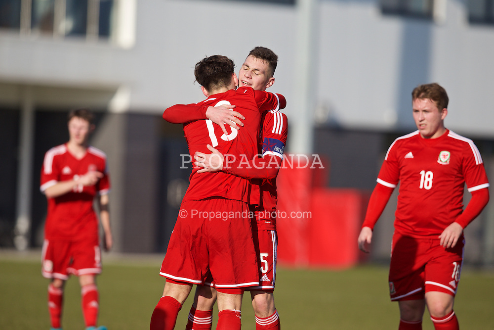 NEWPORT, WALES - Sunday, February 8, 2015: Wales' George Rathbone celebrates scoring a goal against South Wales with team-mate captain Ben Nash during a friendly match at Dragon Park. (Pic by David Rawcliffe/Propaganda)