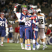 Memebrs of the Boston Cannons celebrate a goal during the game at Harvard Stadium on August 9, 2014 in Boston, Massachusetts. (Photo by Elan Kawesch)