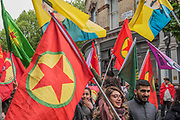 The Kurdistan Workers Party (PKK) show their support for their leader Abdullah Ocalaln - The May Day March from Clerkenwell Green ending with a rally in Trafalgar Square - against cuts and anti 'Trade Union laws. It was supported by several trade unions including UNITE, PCS, ASLEF, RMT, TSSA, NUT, FBU, GMB and UNISON as well as the Peoples Assembly, Pensioners' organisations and organisations representing migrant workers & communities.