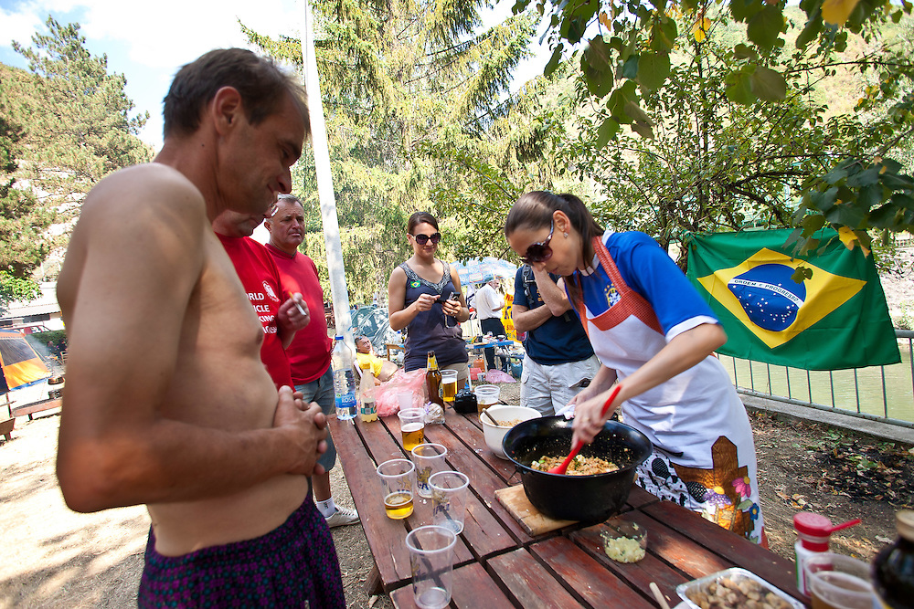 Visitors watch the Brazilan cook at the 2011 World Testicle Cooking Championship, Ovcar Banja, Serbia.