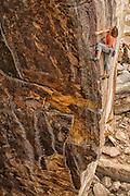 "Elaina Arenz climbing ""Mutiny"" 5.11d. Summersville Lake, West Virginia"
