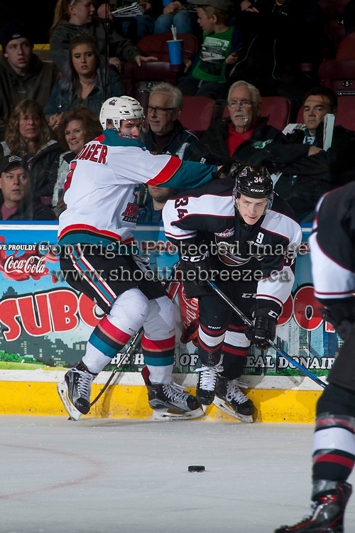 KELOWNA, CANADA - MARCH 10: James Hilsendager #2 of the Kelowna Rockets checks Brayden Watts #34 of the Vancouver Giants into the boards during second period on March 10, 2017 at Prospera Place in Kelowna, British Columbia, Canada.  (Photo by Marissa Baecker/Shoot the Breeze)  *** Local Caption ***