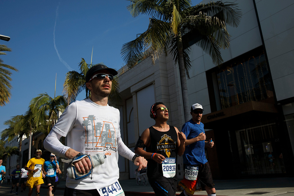 """Runners travel down Rodeo Drive near mile marker 17 during the 32nd annual Los Angeles Marathon on Sunday morning, March 19, 2017 in Beverly Hills, Calif.  The 26.2-mile """"Stadium to the Sea"""" route begins at Dodger Stadium and ends at Ocean and California avenues in Santa Monica. © 2017 Patrick T. Fallon"""