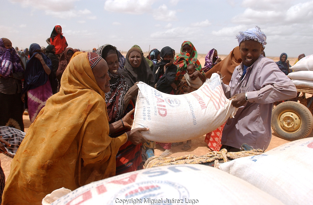 El Barde, Somalia.   People collect  their monthly food ration in a distribution center run by the World Food Programme in El Barde, Somalia.  This region of northern Somalia, close to the Ethiopia's border has been suffering almost two years of a severe drought. (PHOTO: MIGUEL JUAREZ)
