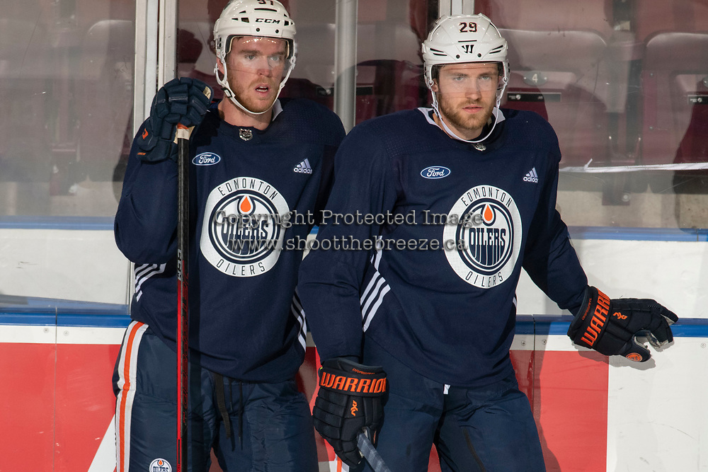 KELOWNA, BC - SEPTEMBER 22:  Connor McDavid #97 and Leon Draisaitl #29 of the Edmonton Oilers stand at the boards during practice at Prospera Place on September 22, 2019 in Kelowna, Canada. (Photo by Marissa Baecker/Shoot the Breeze)