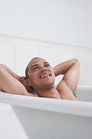 Man relaxing in bathtub