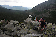 John Walcott, front, leads his son-in-law, Jared Leonard, behind, and childhood friend, Pete Will, in white, through the rocks and boulders that comprise the Cathedral Trail on Mt Katahdin in Maine's Baxter State Park.  Walcott is climbing the mountain, the highest point in Maine, as a 60th birthday celebration.  He has been coming to Baxter State Park almost yearly since 1976.