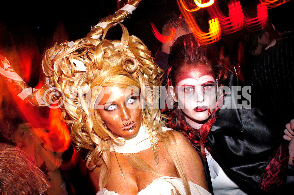 PHILADELPHIA - NOVEMBER 12: Gina Luca (L), 30, and Nikki Carter, 21, of Blackwood, New Jersey show off their designs and hairstyles during Hairball 9 at Shampoo Niteclub November 12, 2005 in Philadelphia, Pennsylvania. Hairball, which is the East Coast's largest annual hair design competition featured models sporting outrageous themed hair designs and parade the catwalk. All proceeds from the event will benefit cancer and HIV/AIDS research and treatment at the world-renowned City of Hope National Medical Center and Beckman Research Institute. (Photo by William Thomas Cain/photodx.com)