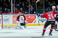 KELOWNA, CANADA - NOVEMBER 29: Liam Kindree #26 of the Kelowna Rockets celebrates a goal as Isaiah DiLaura #33 of the Prince George Cougars reacts to a missed save  on November 29, 2017 at Prospera Place in Kelowna, British Columbia, Canada.  (Photo by Marissa Baecker/Shoot the Breeze)  *** Local Caption ***