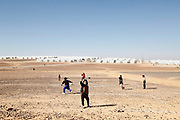 Syrian refugee children playing football near the Azraq camp in northern Jordan.<br /> <br /> Picture: Russell Watkins/DFID