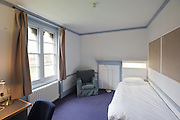 Study bedroom showing bed, chair and window