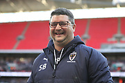 AFC Wimbledon first team coach Simon Bassey laughing during the The FA Cup 3rd round match between Tottenham Hotspur and AFC Wimbledon at Wembley Stadium, London, England on 7 January 2018. Photo by Matthew Redman.