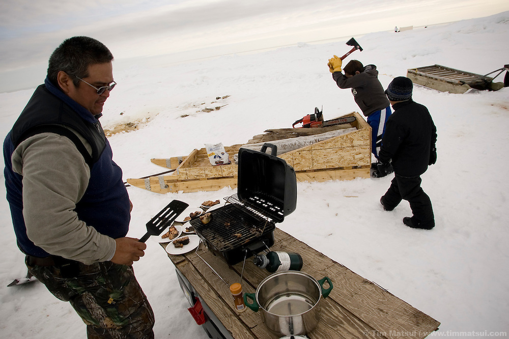 May 3, 2008 -- Kivalina, AK, U.S.A..Austin Swan's whaling camp, two miles out on the melting pack ice and 12 miles from the native village of Kivalina, Alaska. Kivalina is suing 20 oil companies for property damage related to global warming; the ocean pack ice forms later and melts earlier, leaving the town vulnerable to erosive winter storms and endangering their traditional subsistence lifestyle. (Photo by Tim Matsui)
