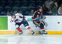 KELOWNA, CANADA - OCTOBER 16: Henrik Nyberg #21 of the Kelowna Rockets is stick checked by a member of the Lethbridge Hurricanes on October 16, 2013 at Prospera Place in Kelowna, British Columbia, Canada.   (Photo by Marissa Baecker/Shoot the Breeze)  ***  Local Caption  ***