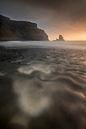 Tidal outflow over Talisker beach, Skye, Scotland.
