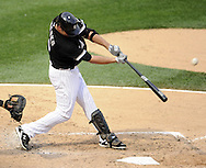 CHICAGO - JULY 09:  Paul Konerko #14 of the Chicago White Sox hits a sacrifice fly in the sixth inning against the Minnesota Twins on July 9, 2011 at U.S. Cellular Field in Chicago, Illinois.  The White Sox defeated the Twins 4-3.  (Photo by Ron Vesely)  Subject: Paul Konerko