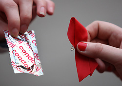 "Red Cross World Aids Day event in Glasgow, where 200 covert campaigners ""freeze"" in the act of handing each other ribbons and condoms on the Royal Concert Hall steps."