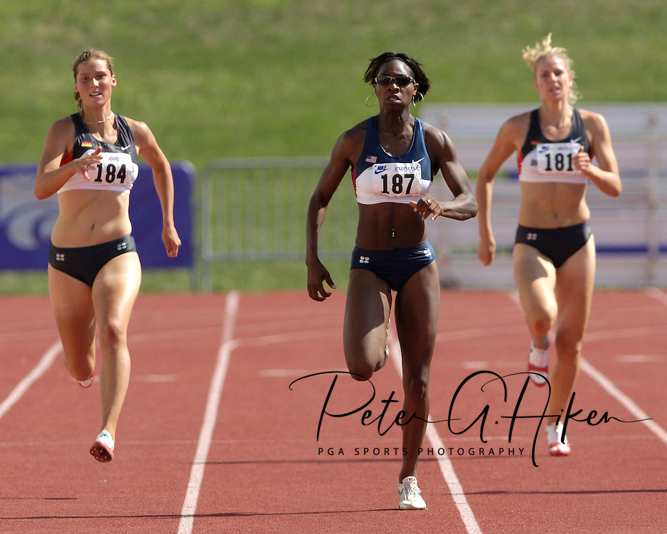Lela Nelson of the United States (187) sprints past Germany's Marlen Buder (181) and Maren Schwerdtner (184) to win the 200-meter dash in the hepthathlon, at the Nike Combined Events Challenge at the R.V. Christian Track Complex on the campus of Kansas State University in Manhattan, Kansas, August 5, 2006.