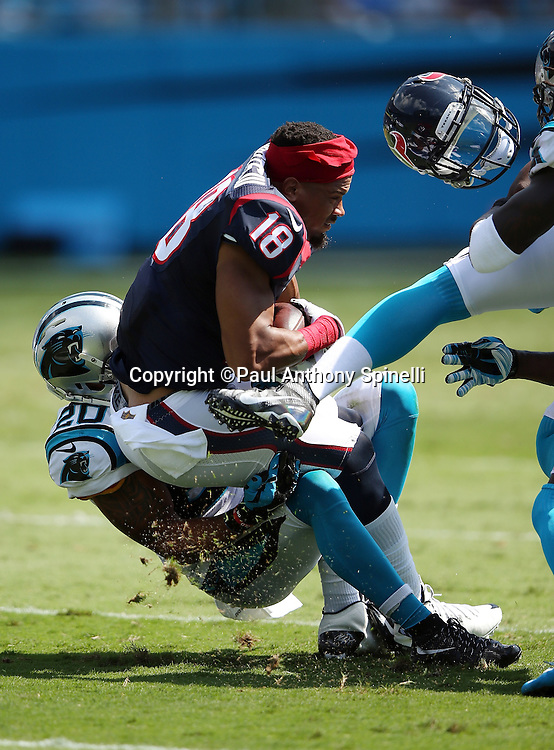 Houston Texans wide receiver Cecil Shorts III (18) catches a first quarter pass and loses his helmet on a tackle by Carolina Panthers free safety Kurt Coleman (20) during the 2015 NFL week 2 regular season football game against the Carolina Panthers on Sunday, Sept. 20, 2015 in Charlotte, N.C. The Panthers won the game 24-17. (©Paul Anthony Spinelli)