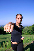 punch - attractive young woman practicing self defense
