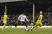 Fulham striker Aboubakar Kamara (47) chips the ball over Burton Albion goalkeeper Stephen Bywater (1) and scores a goal to make the score 6-0 to Fulham during the EFL Sky Bet Championship match between Fulham and Burton Albion at Craven Cottage, London, England on 20 January 2018. Photo by Richard Holmes.