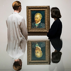 "© Licensed to London News Pictures. 25/03/2019. LONDON, UK. Staff members view ""Self-Portrait"", 1887, by Vincent Van Gogh.  Preview of ""The EY: Van Gogh and Britain"" exhibition at Tate Britain, the first exhibition to look at the work of Vincent Van Gogh through his relationship with Britain and how he inspired British artists.  Over 50 of his works are on display 27 March to 11 August 2019.  Photo credit: Stephen Chung/LNP"