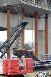 Support Columns, Crane, Pearl Harbor Memorial Bridge under Construction at New Haven Harbor Crossing, Connectictut. CONNDOT Contract B, Project #92-618. When complete the alternately named Quinnipiac River Bridge will be first Extradosed Engineered & Designed Bridge in the United States.