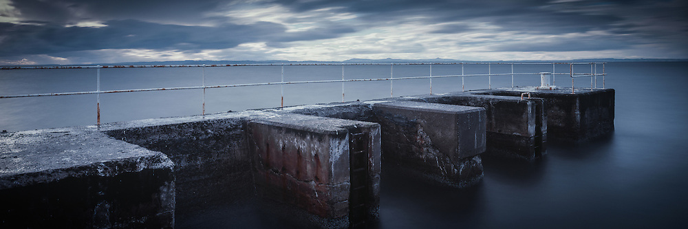 The breakwater at Port Seton in East Lothian on a cloudy, using a long exposure