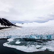 A glacier spills out into the sea from Franz Joseph Land