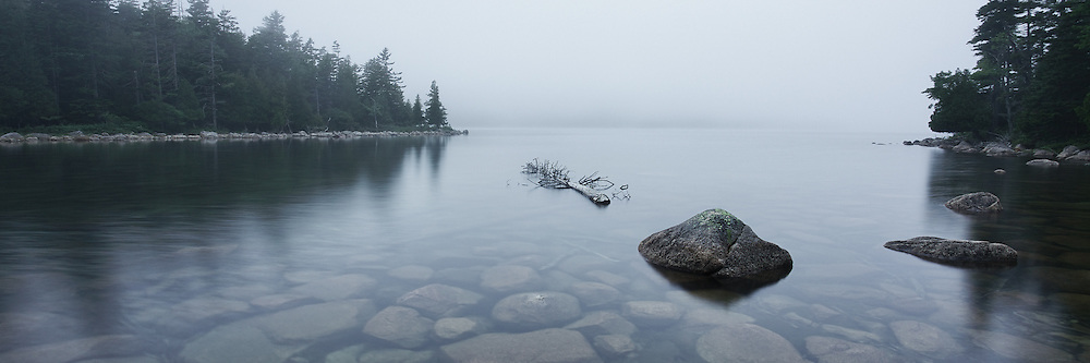 Jordan Pond in Acadia National Park takes on a quiet serenity when shrouded in fog. The air feels muffled and the normal sounds one expects from nature dissapate into the atmosphere. Pause and reflect.