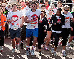 Eastenders actors Tony Discipline and Matt Lapinskas taking part in a one mile run for Sport Relief charity in London, 25th March 2012.  Photo by: i-Images