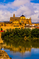 Mezquita (Mosque-Cathedral of Cordoba) with the Rio Guadalquivir (river) in foreground, Cordoba, Cordoba Province, Andalusia, Spain.