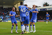 Gillingham forward Frank Nouble (45) and teammates celebrate Gillingham forward Cody MacDonald (10) scoring the first goal (1-0) during the EFL Sky Bet League 1 match between Gillingham and Oldham Athletic at the MEMS Priestfield Stadium, Gillingham, England on 8 October 2016. Photo by Martin Cole.