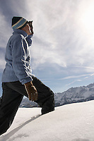 Man walking in fresh snow side view