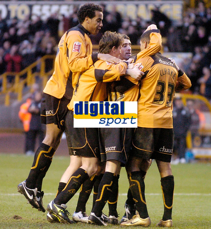 Photo: Glyn Thomas.<br />Wolverhampton Wanderers v Plymouth Argyle. Coca Cola Championship. 31/12/2005.<br />Wolves' Colin Cameron is mobbed by teammates after scoring his side's equaliser.