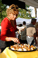 A lady gets a sample from the Gordon Food Service Marketplace booth during the 21st annual The Taste in the Lincoln Park Commons area at the Fraze Pavilion, Thursday, September 3, 2009.